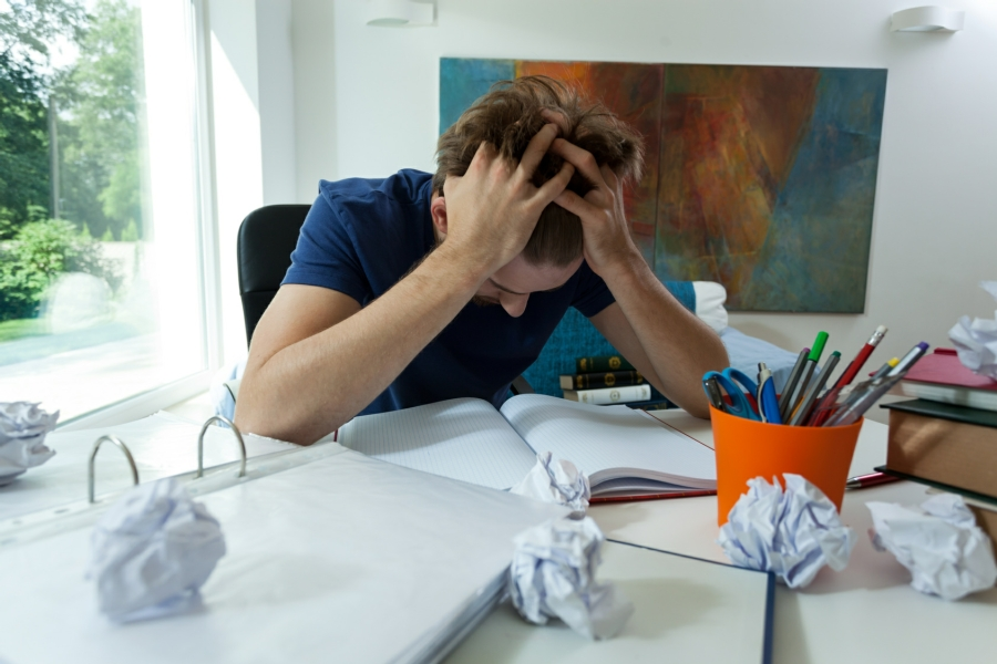 Hypnotherapy for Exam Nerves in Your Town - student feeling stress of revision
