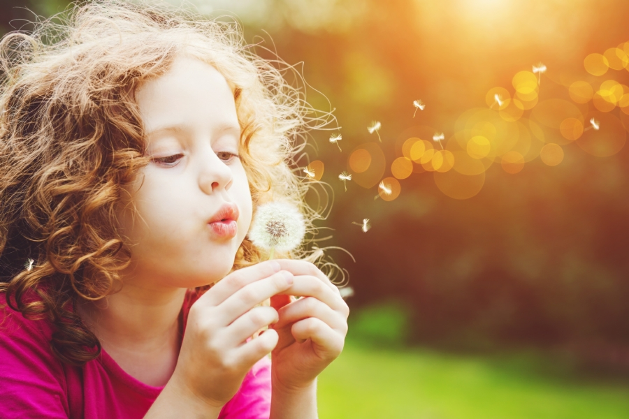 Hypnosis for Children in Your Town - Young girl blowing dandelion