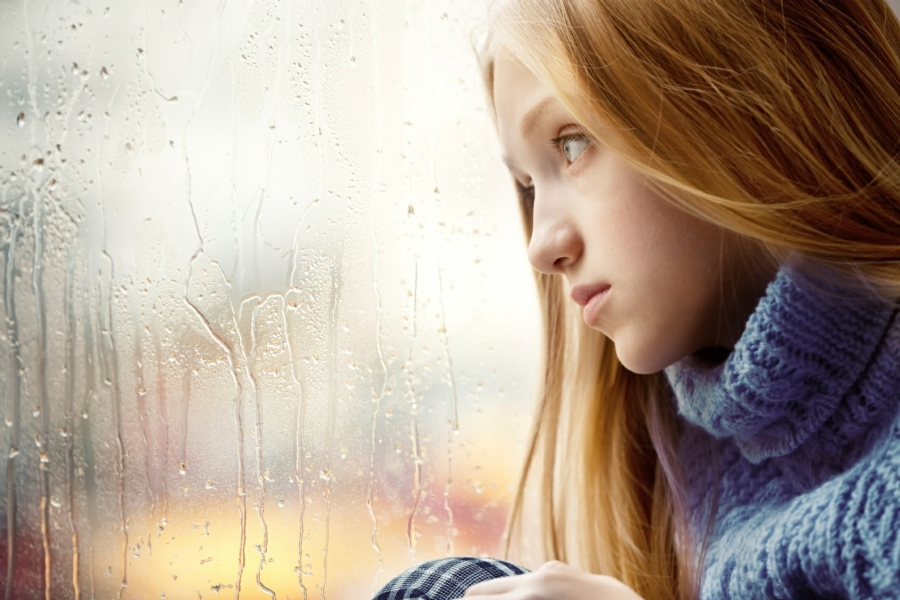 Hypnotherapy for Low Self Confidence in Your Town - Young Woman Gazing Out of Window