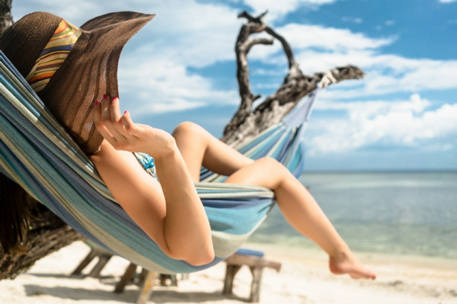 Hypnotherapy for Relaxation in Your Town - woman relaxing on tropical beach