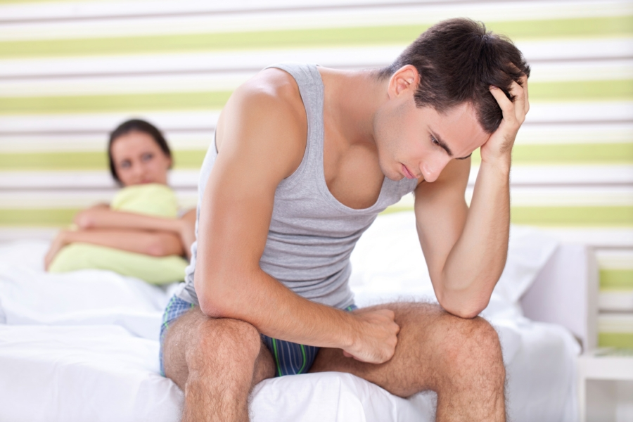 Hypnotherapy for Sexual Problems in Your Town - Man in bed with woman feeling dejected