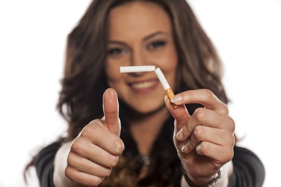 stop smoking hypnotherapy in Your Town - woman breaking cigarette