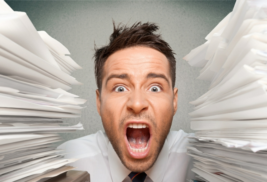 Hypnotherapy for Stress in Your Town - Man overwhelmed by paperwork