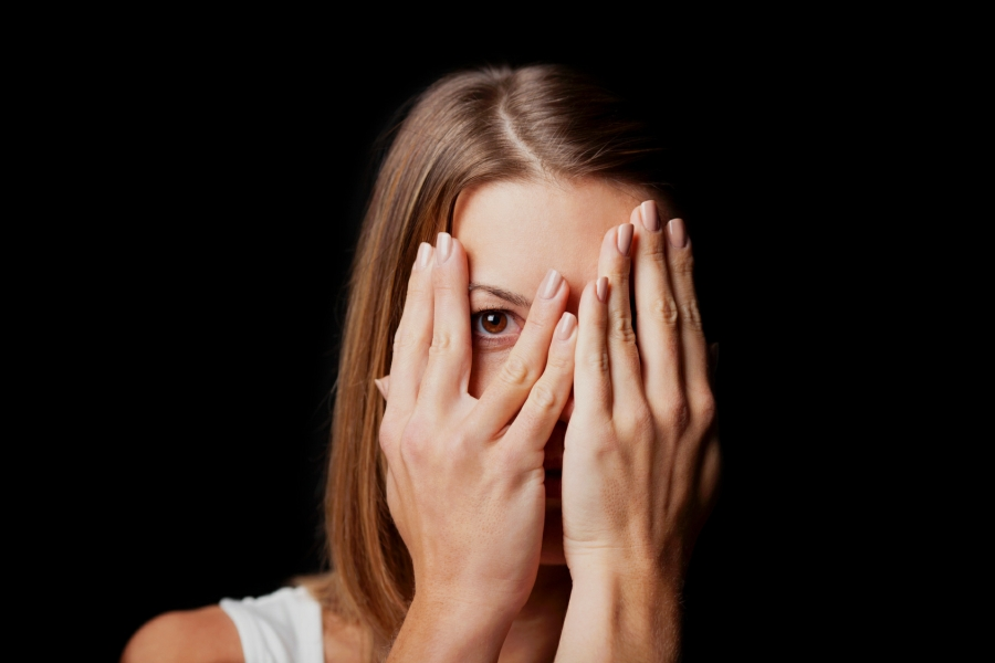blushing hypnotherapy in Your Town - woman hiding face