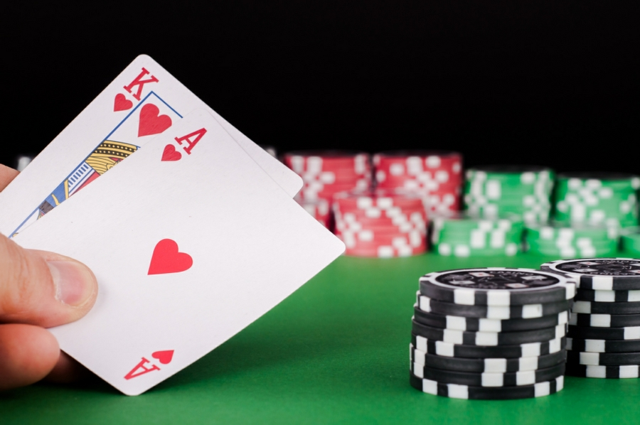 hypnotherapy for gambling addiction in your town - winning hand of cards